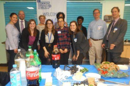 Individuals Volunteer at Local Bronx Food Pantry ADAPT Community